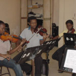 3 - violin students practicing