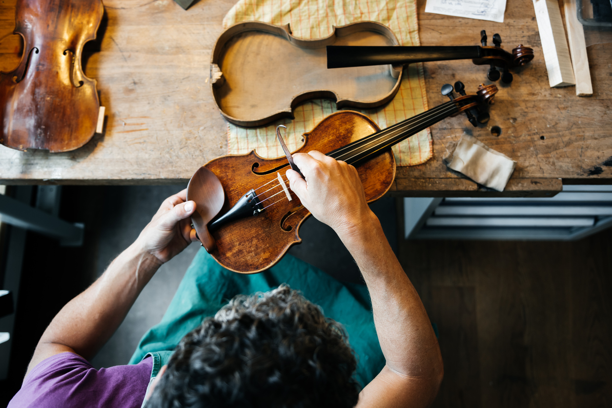 A luthier at work on a violin